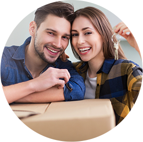 Couple leaning against a moving box.