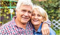 Senior man with his arm around a senior woman